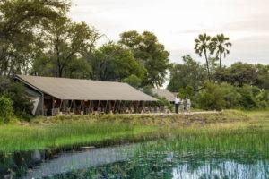 gomoti camp machaba lodge from water