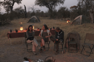 selinda spillway walking safari camp tents and campfire
