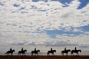 Makgadikgadi Botswana horse riding over plains