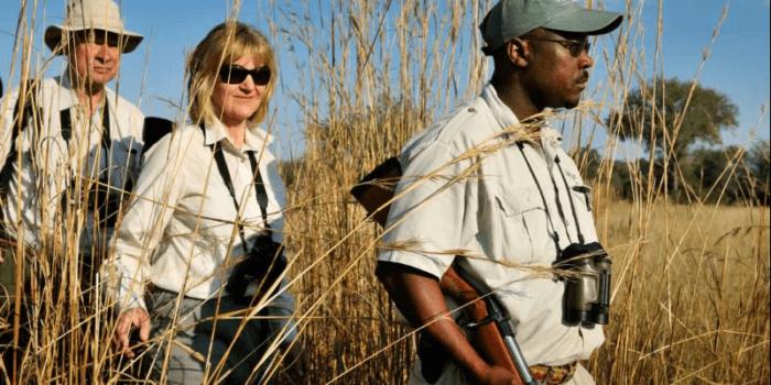 Okavango delta guest and guide walking safari