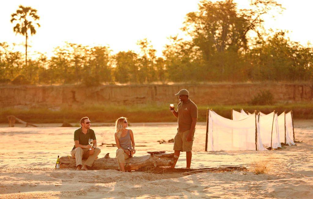 zambia south luangwa walking safari sunset drinks at sleepout