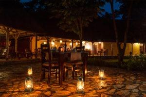 primate lodge kibale dinner outside